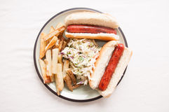 Hot dogs, fies and cole slaw Royalty Free Stock Photography