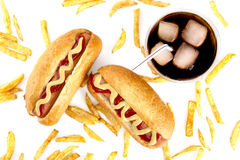 Hot dogs with french fries from above on white Stock Images