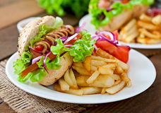 Hot Dogs with French fries on white plate. Royalty Free Stock Image