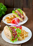 Hot Dogs with French fries on white plate. Royalty Free Stock Photography