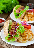 Hot Dogs with French fries on white plate Stock Photo