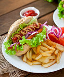 Hot Dogs with French fries on white plate Stock Photos