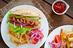 Hot Dogs with French fries on white plate Stock Photography
