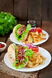 Hot Dogs with French fries on white plate Royalty Free Stock Photo
