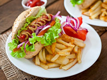 Hot Dogs with French fries on white plate Stock Images