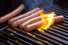 Hot Dogs on Grill. Group of Hot Dogs being cooked on a barbeque grill Royalty Free Stock Photos