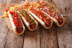 Hot dogs with ketchup, mustard, onions and french fries. horizon Stock Photo