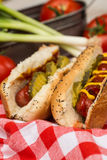Hot Dogs With Ketchup Mustard and Pickles Stock Images
