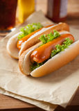 Hot dogs for meal on paper Stock Photography