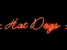 Hot dogs neon sign. Close up of hot dogs neon sign Royalty Free Stock Images