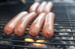 Hot Dogs On The Grill Royalty Free Stock Images