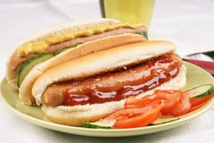 Hot Dogs with salad Royalty Free Stock Images
