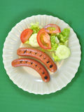 Hot dogs salad Stock Images