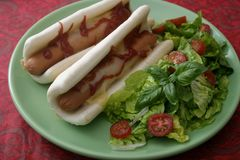 Hot Dogs with salad Royalty Free Stock Photo