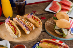 Hot dogs on wooden table with 4th july theme Royalty Free Stock Photos