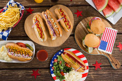 Hot dogs on wooden table with 4th july theme Royalty Free Stock Photo