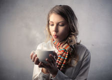 Hot drink. Young woman holding a bowl of hot drink Stock Image