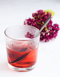 A hot drink. And a flower Stock Photos
