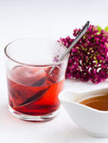 A hot drink. And a flower Royalty Free Stock Photography