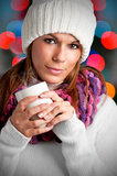 Hot Drink. Young woman drinking a hot drink from a white mug Royalty Free Stock Photos