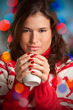Hot Drink. Young woman drinking a hot drink from a white mug Royalty Free Stock Photography