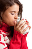 Hot Drink. Young woman drinking a hot drink from a white mug, isolated in a white background Royalty Free Stock Images