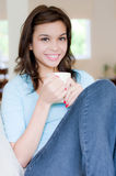 Hot Drink. An attractive young woman drinking coffee at home Stock Photo