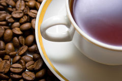 Hot drink. Cup with hot drink on a coffee beans background Royalty Free Stock Image