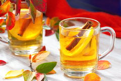 Hot drink with apple juice, lemon and cinnamon in autumn Stock Photos