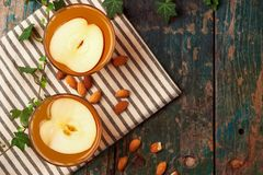 Hot drink of apple tea with cinnamon stick. Hot drink with apple Stock Image
