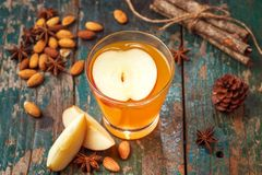 Hot drink of apple tea with cinnamon stick. Hot drink with apple Royalty Free Stock Photography