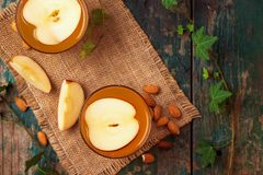 Hot drink of apple tea with cinnamon stick. Hot drink with apple royalty free stock image