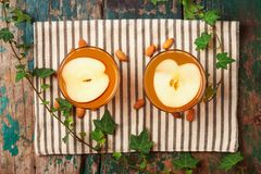 Hot drink of apple tea with cinnamon stick. Hot drink with apple Stock Photography