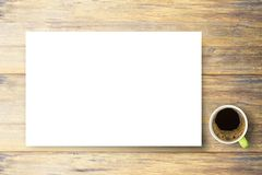 Hot drink - Blank white paper and coffee cup on brown old wood stock photo