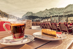 Hot drink and cake at a mountain resort Royalty Free Stock Photos