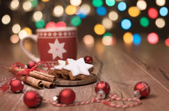 Hot drink, Christmas cookies and candy cane on the table Royalty Free Stock Photos