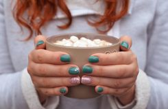 Hot  drink cocoa , coffee with marshmallow. Aromatic hot  drink cocoa , coffee with marshmallow in a beautiful cup at the girl in hands Royalty Free Stock Photography