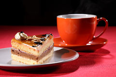 Hot drink and coffee cake with whipped cream Stock Image