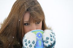 Hot Drink Cold Girl. Brunette girl with a hot drink on a cold winter day Royalty Free Stock Photography