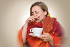 Hot drink from a cup. Royalty Free Stock Images