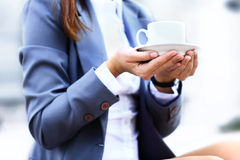 Hot drink in cup in hands Royalty Free Stock Photography