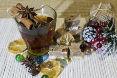Hot drink among the holiday decorations. stock photos