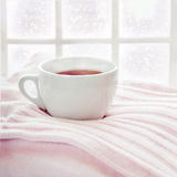 Hot drink on knitted sweater Stock Photos
