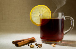 Hot drink with lemon. Royalty Free Stock Images
