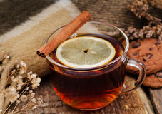 Hot drink with a lemon and cinnamon Stock Photo