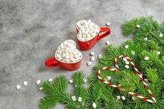 Hot drink marshmallow red Christmas decoration. Hot drink with marshmallow and red Christmas decoration. Holidays food stock images