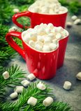 Hot drink marshmallow red Christmas decoration vintage toned. Hot drink with marshmallow and red Christmas decoration. Vintage style toned picture royalty free stock photo