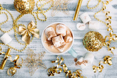 Hot drink with marshmallows on wooden table Stock Photos