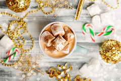 Hot drink with marshmallows on wooden table Royalty Free Stock Photography