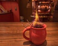 Hot drink, mulled wine and burning sugar Royalty Free Stock Photo